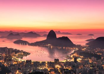 Rio de Janeiro just before Sunrise, City Lights, and Sugarloaf Mountain.